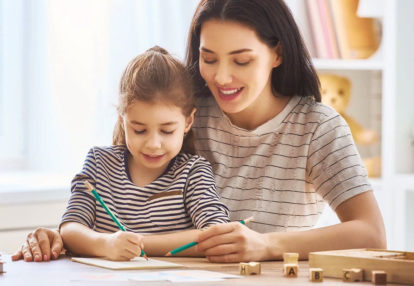 adult woman teaching a child